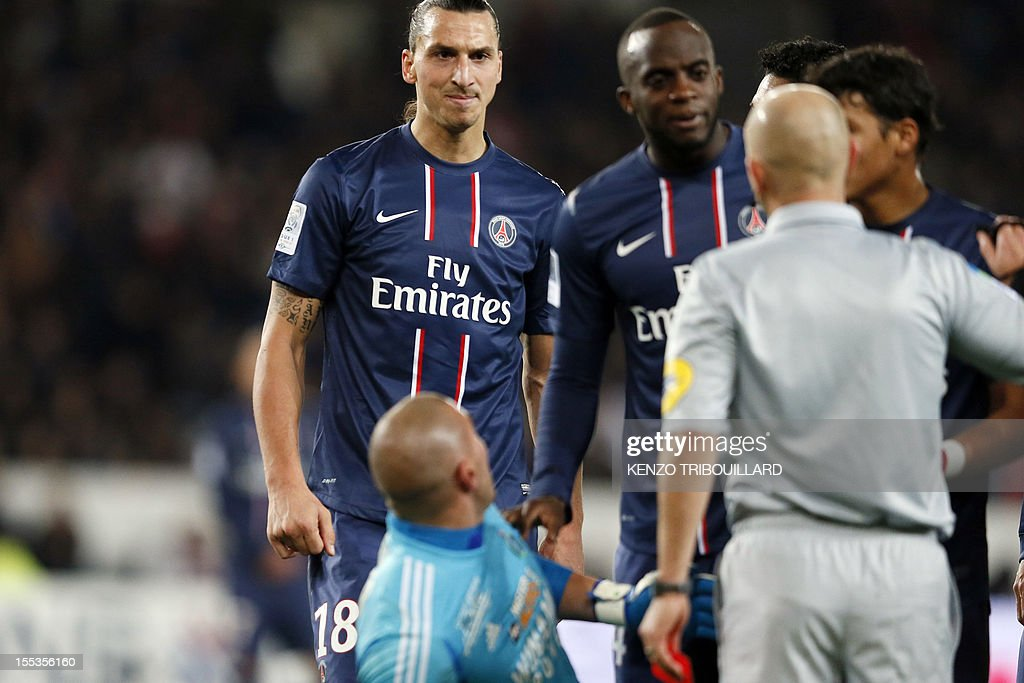 French referee Laurent Duhamel gives a red card to Paris Saint-Germain's Swedish forward Zlatan Ibrahimovic (L) during the French L1 football match Paris Saint-Germain (PSG) vs Saint-Etienne (ASSE) on November 3, 2012 at the Parc des Princes stadium in Paris.