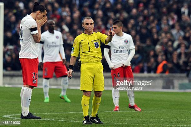 French referee Lionel Jaffredo gestures next to Paris SaintGermain's Swedish forward Zlatan Ibrahimovic during the French L1 football match between...