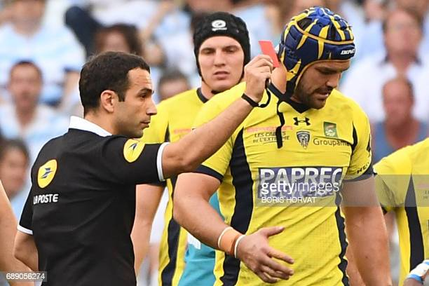 French referee Mathieu Raynal presents a red card to Clermont's South African lock Phillip Van Der Merwe during the French Top 14 rugby union...