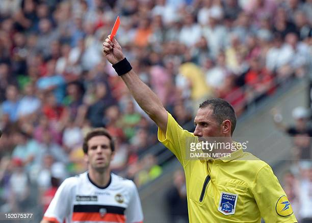 French referee Mikael Lesage gives a red card to Lorient's French goalkeeper Fabien Audard during the French L1 football match Rennes against Lorient...