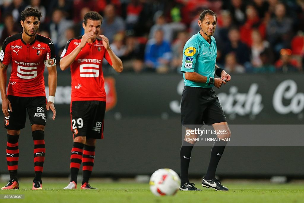 French referee Mikael Lesage looks on during the French L1 football match between Stade Rennais FC and AS Nancy Lorraine on August 20 2016 at the...