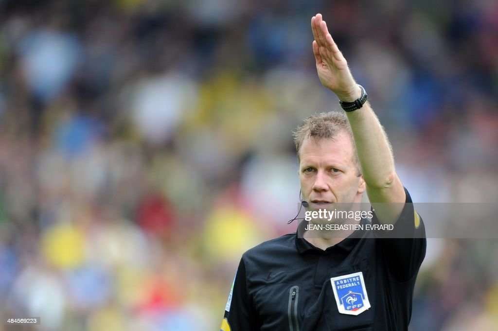 French referee Olivier Thual gestures during the French L1 football match between Nantes and Guingamp on April 13, 2014 at the Beaujoire stadium in Nantes, western France.