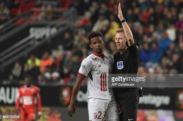 French referee Olivier Thual gestures during the French L1 football match between Rennes and Lille on October 21 2017 at the Roazhon Park of Rennes...