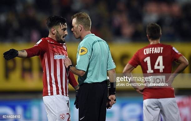 French referee Olivier Thual speaks with Nancy's SpanishUruguayan defender Erick Cabaco during the French L1 football match between Nancy and Dijon...