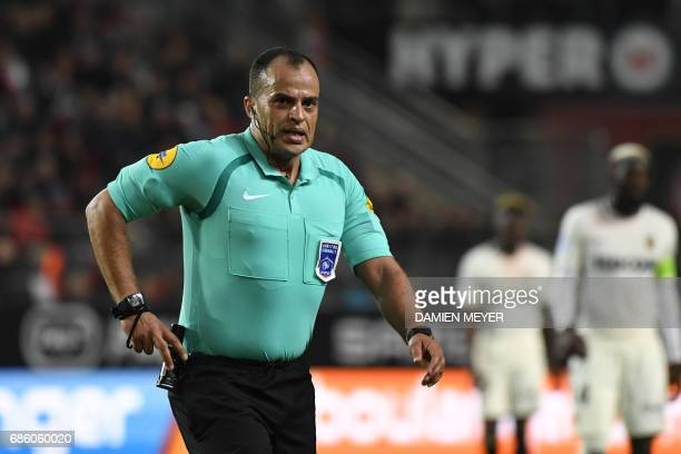 French referee Said Ennjimi gestures during the French L1 football match between Rennes and Monaco on May 20 2017 at the Roazhon Park stadium in...