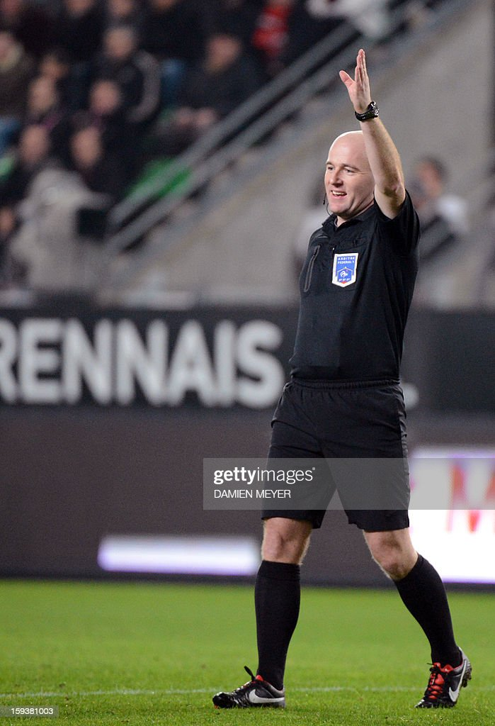 French referee Sebastien Moreira gestures during the French L1 football match between Rennes and Bordeaux on January 12, 2013, at the Route de Lorient stadium in Rennes, western France. AFP PHOTO / DAMIEN MEYER