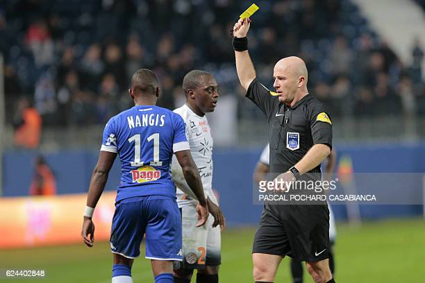 French referee Sebastien Moreira gives a yellow card to Bastia's French midfielder Lenny Nangis during the French L1 football match between Bastia...