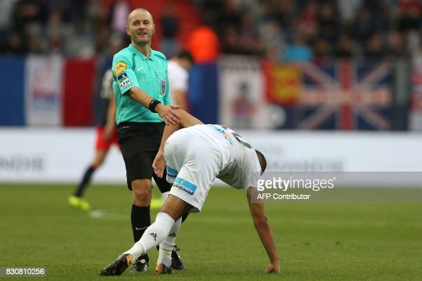 French referee Stephane Jochem looks on during the French L1 football match between Caen and SaintEtienne on August 12 at the Michel d'Ornano stadium...