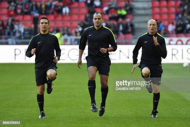 French referees Eric Danizan Said Ennjimi and Cyril Saint Cricq Lompre warm up prior to the French L1 football match between Rennes and Monaco on May...