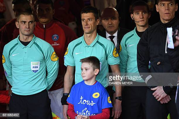 French referees Frederic Haquette Benoit Bastien Julien Pacelli and Yohann Rouinsard attend the French L1 football match between Rennes and Paris...
