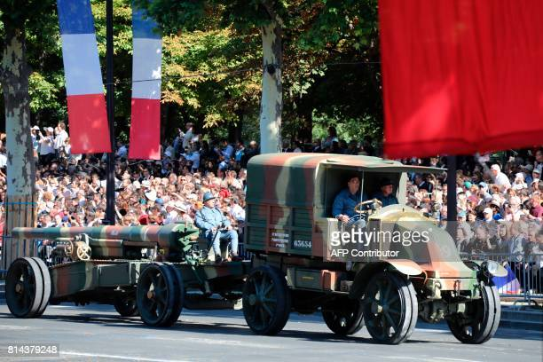 A French Renault EG15 military vechicle from 1914 parades during the annual Bastille Day military parade on the ChampsElysees avenue in Paris on July...