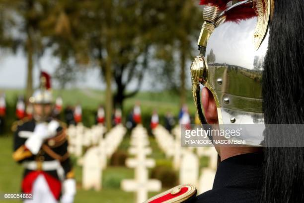 A French Republican Guard stands at CernyenLaonnois cemetery during a ceremony marking the 100th anniversary of the Chemin des Dames battle on April...
