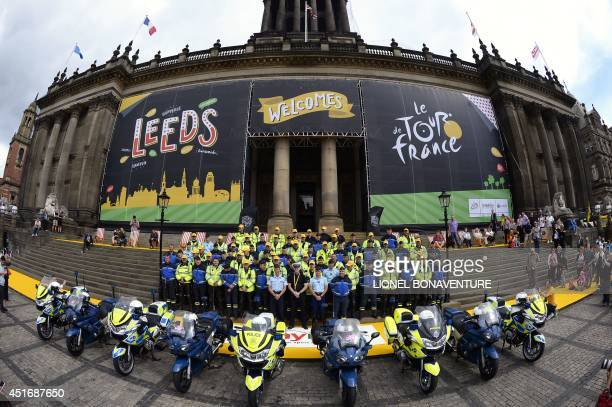 French Republican Guards and British policemen pose for a family picture on July 4 2014 in front of the city hall of Leeds northern England as they...