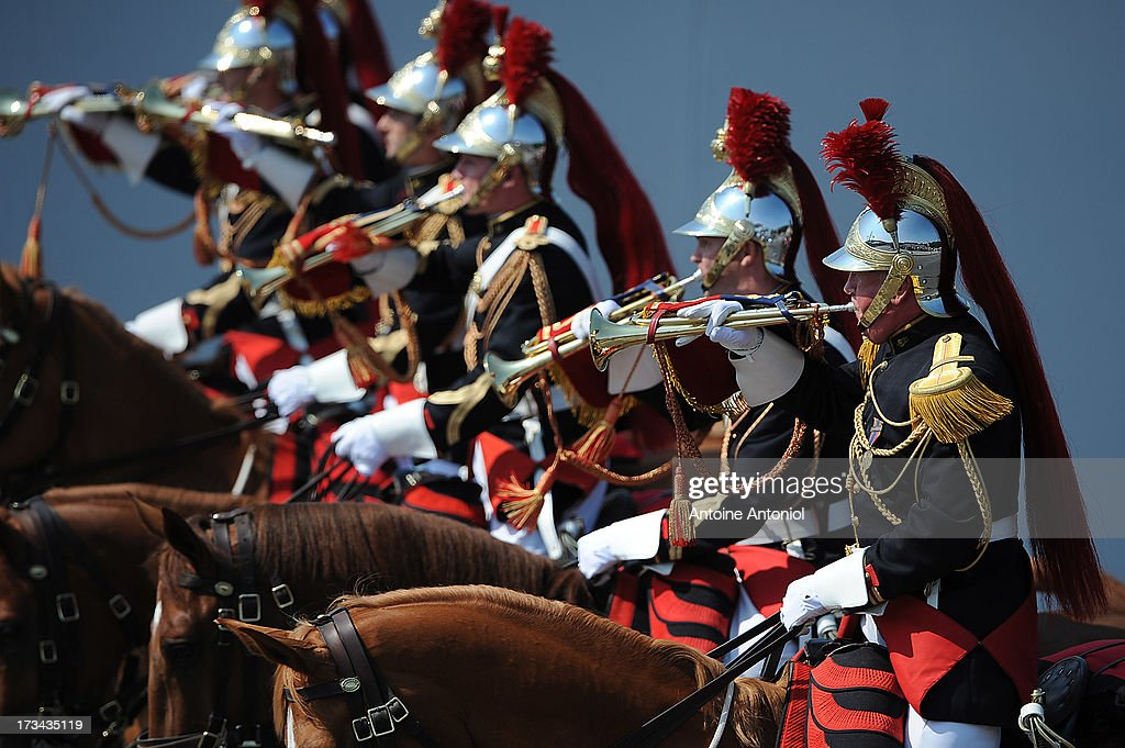 French Republican Guards parade during the Bastille Day parade on the Champs Elysees on July 14, 2013 in Paris, France. The annual military ceremony is the largest in Europe remembering the 'Fete de la Federation' for 1790.