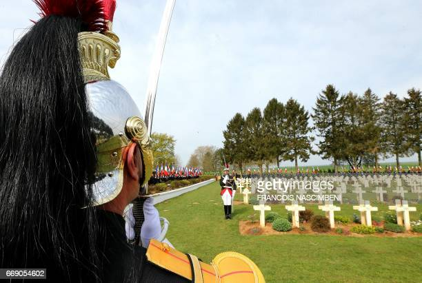 French Republican Guards stand at CernyenLaonnois cemetery during a ceremony marking the 100th anniversary of the Chemin des Dames battle on April 16...