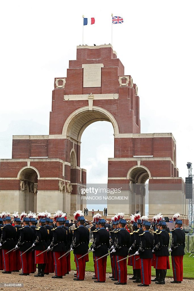 French Republican Guards stand by the Thiepval Memorial on July 1, 2016 during a ceremony marking the 100th anniversary of the World War I battle at the River Somme, northern France. Under grey skies, unlike the clear sunny day that saw the biggest slaughter in British military history a century ago, the commemoration kicked off at the deep Lochnagar crater, created by the blast of mines placed under German positions two minutes before the attack began at 7:30 am on July 1, 1916. / AFP / FRANCOIS