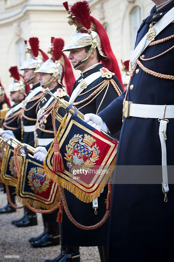 French Republican guards (French honor guard) stand following a State visit's lunch at the Elysee presidential palace in Paris on February 6, 2012.
