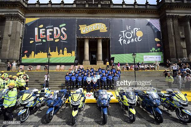 French Republican Guards working on Tour de France security pose for a family picture in front of the city hall of Leeds northern England on July 4...