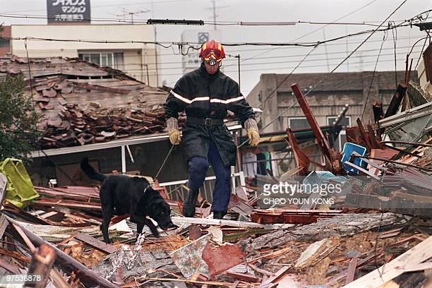 A French rescue team works over the debris of a collapsed building on January 22 1995 five days after the massive earthquake on January 17 1995 in...