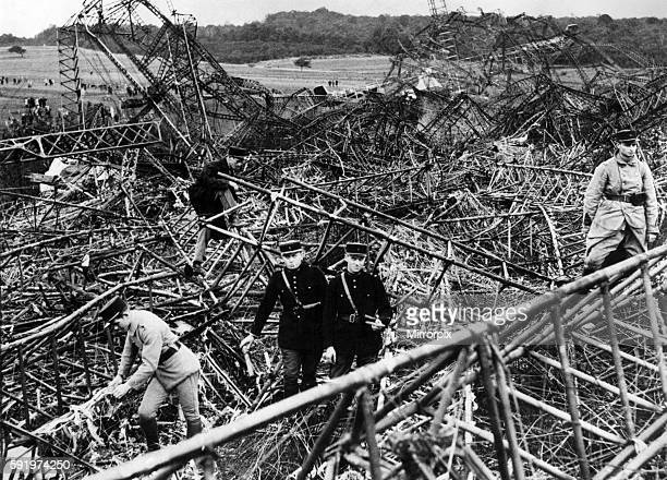 French rescue workers and police amongst the wreckage of the R101 airship after it crashed near Beauvais France October 1930