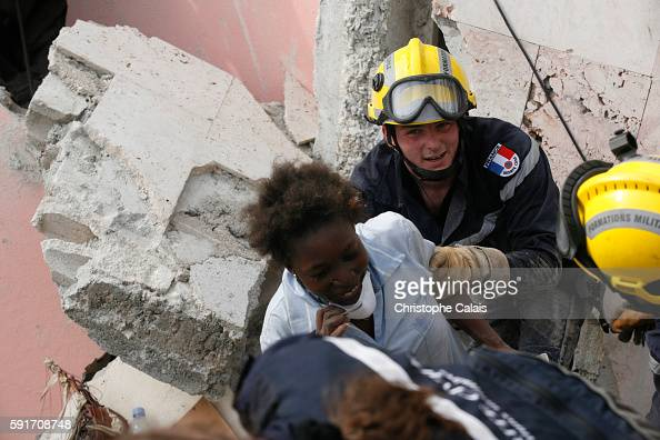 French rescuers from the Brignoles UIISC 7 Instruction and Intervention Unit section Verdi 11 organize the rescue of a young Haitian babysitter Rose...