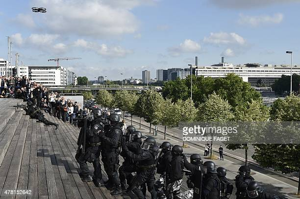 French Research and Intervention Brigades policemen officers use a drone during a training exercice at the Bibliotheque Nationale de France in Paris...