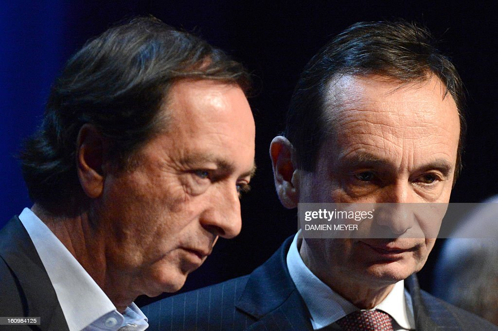French retailing group Carrefour's general secretary Jerome Bedier (R) and French hypermarket chain Leclerc's president Michel-Edouard Leclerc attend a general meeting of the 'Made in Britanny' association in Saint-Malo, western France on February 8, 2013. AFP PHOTO DAMIEN MEYER