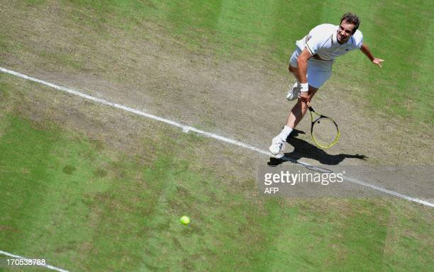 French Richard Gasquet serves during his match against German Florian Mayer at the ATP Gerry Weber Open tennis tournament in Halle on June 14 2013...