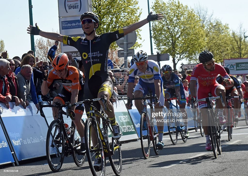 French rider Bryan Coquard of team Direct Energie (2nd L) celebrates as he wins the 'Quatre Jours de Dunkerque' (Four Days of Dunkirk) cycling race on May 4, 2016 in Gravelines, north of France. / AFP / FRANCOIS