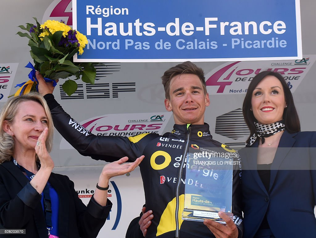 French rider Bryan Coquard of team Direct Energie celebrates on the podium after winning the 'Quatre Jours de Dunkerque' (Four Days of Dunkirk) cycling race on May 4, 2016 in Gravelines, north of France. / AFP / FRANCOIS