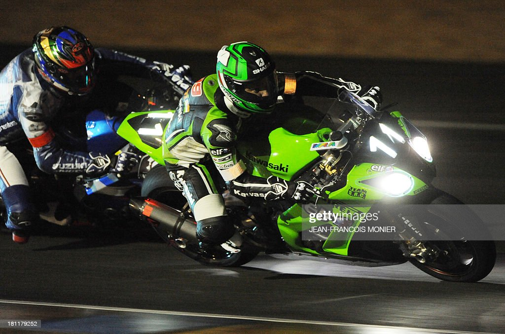 French rider Fabien Foret (R) on his Kawasaki ZX10 N°11 competes ahead of French pilot Alexander Cudlin (L) on his Suzuki GSXR 1000 N°1 during the night practice session of the Le Mans 24-Hour endurance moto race on September 19, 2013, in Le Mans, western France. 168 riders on 56 motorcycles will take part in the 36th 24 Hours of Le Mans, on September 21, 2013.