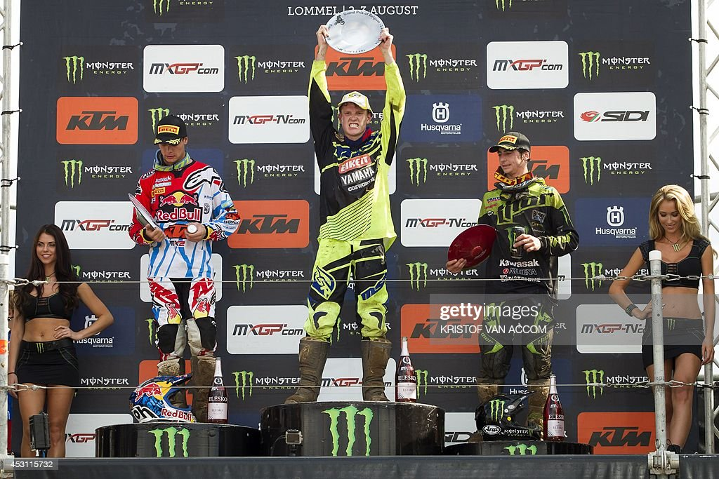 French rider Jordi Tixier, British rider Max Anstie and French rider Dylan Ferrandis celebrate on the podium after the motocross MX2 Belgian Grand Prix, on August 3, 2014, in Lommel. AFP PHOTO / BELGA / KRISTOF VAN ACCOM
