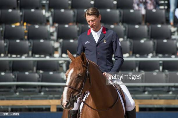 French rider Kevin Staut takes a lap of honor at Ullevi Stadium in Gothenburg Sweden on August 23 2017 after placing fifth in the qualifyer for the...