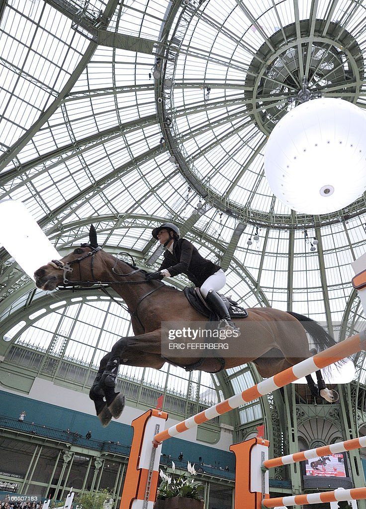 French rider Penelope Leprevost and her horse Nice Stéphanie jump during the Hermes Jumping competition at the Grand Palais in Paris on April, 2013. Leprevost won the Saut Hermes CSI 5* class 6 with German Marcus Ehning.