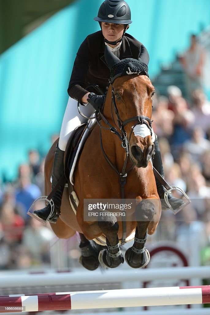 French rider Penelope Leprevost on Nayana clears an obstacle on April 14, 2013 during the jumping event of the Grand Prix Hermes of Paris at the Grand Palais in Paris.