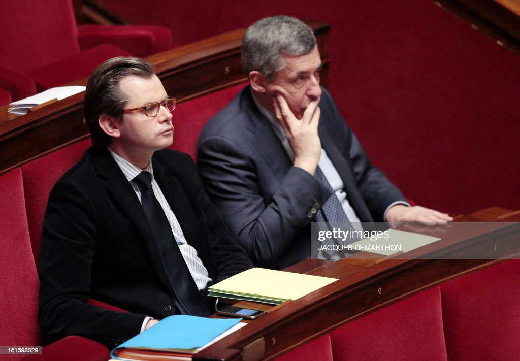 French right wing opposition party (UMP) MPs Guillaume Larrivee (L) and Henri Guaino attend the presentation of a bill on separation and regulation of banking activities on February 12, 2013 at the French National Assembly in Paris.