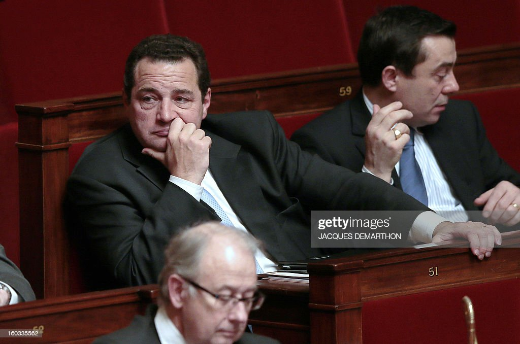 French right wing Party (UMP) MP Jean-Frederic Poisson (L) attends a speech at the National Assembly on January 29, 2013 in Paris. The French National Assembly is due to begin a marathon debate on legalising same-sex marriage after months of public protests and counter-protests.