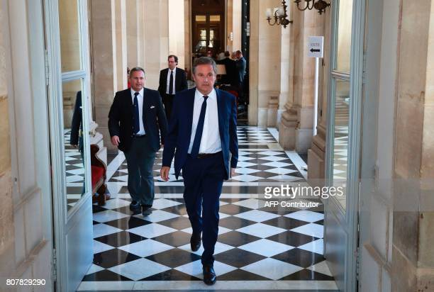 French rightwing Debout la France party member of Parliament Nicolas DupontAignan walks at the French National Assembly in Paris on July 4 while...