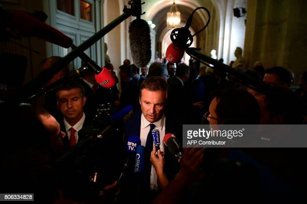 French rightwing Debout la France party's member of Parliament Nicolas DupontAignan answers the press after the French President gave a speech during...