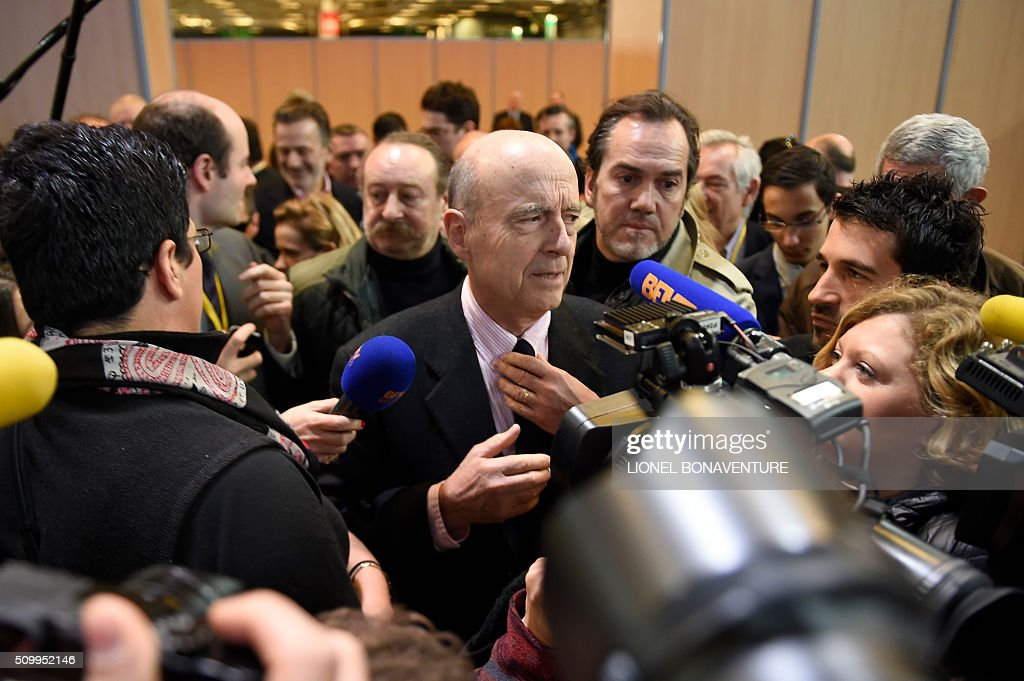 French right-wing Les Republicains (LR) party member, foreseen as the frontrunner in next year's presidential election, Alain Juppe arrives to attend the LR National Council on February 13, 2016 in Paris. AFP PHOTO / LIONEL BONAVENTURE / AFP / LIONEL BONAVENTURE