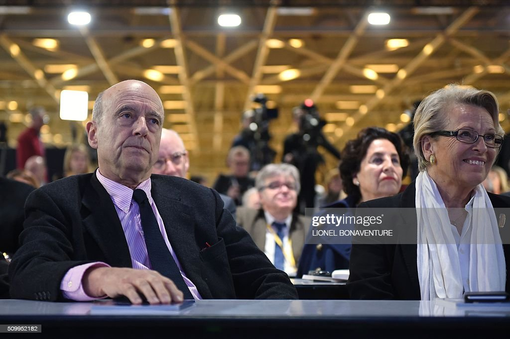 French right-wing Les Republicains (LR) party member, foreseen as the frontrunner in next year's presidential election, Alain Juppe (L) and LR party member and former French Foreign Minister Michele Alliot-Marie attend the LR National Council on February 13, 2016 in Paris. AFP PHOTO / LIONEL BONAVENTURE / AFP / LIONEL BONAVENTURE