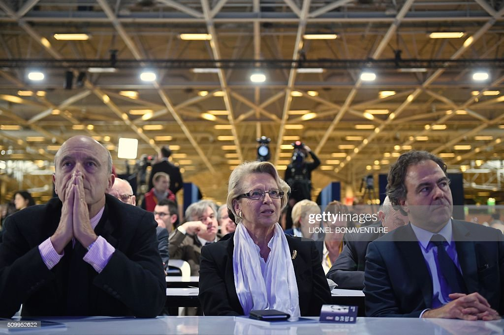 French right-wing Les Republicains (LR) party member, foreseen as the frontrunner in next year's presidential election, Alain Juppe (L), former French Foreign Minister Michele Alliot-Marie (C) and LR party member Luc Chatel attend the LR National Council on February 13, 2016 in Paris. AFP PHOTO / LIONEL BONAVENTURE / AFP / LIONEL BONAVENTURE