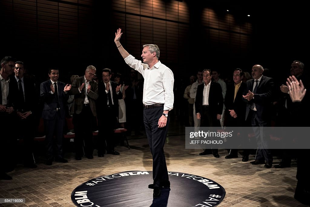 French right-wing Les Republicains (LR) party MP and candidate for LR party's primary for the 2017 presidential elections, Bruno Le Maire, waves to the crowd, on May 27, 2016 during a meeting in Lyon, central eastern France. / AFP / JEFF