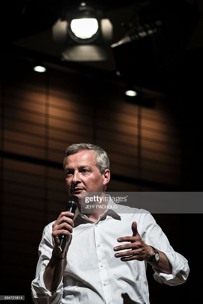 French right-wing Les Republicains (LR) party MP and candidate for LR party's primary for the 2017 presidential elections, Bruno Le Maire, gives a speech on May 27, 2016 during a meeting in Lyon, central eastern France. / AFP / JEFF