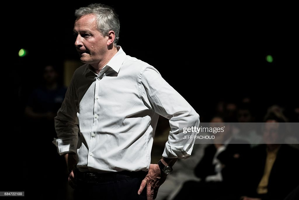 French right-wing Les Republicains (LR) party MP and candidate for LR party's primary for the 2017 presidential elections, Bruno Le Maire, listens to questions of supporters, on May 27, 2016 during a meeting in Lyon, central eastern France. / AFP / JEFF