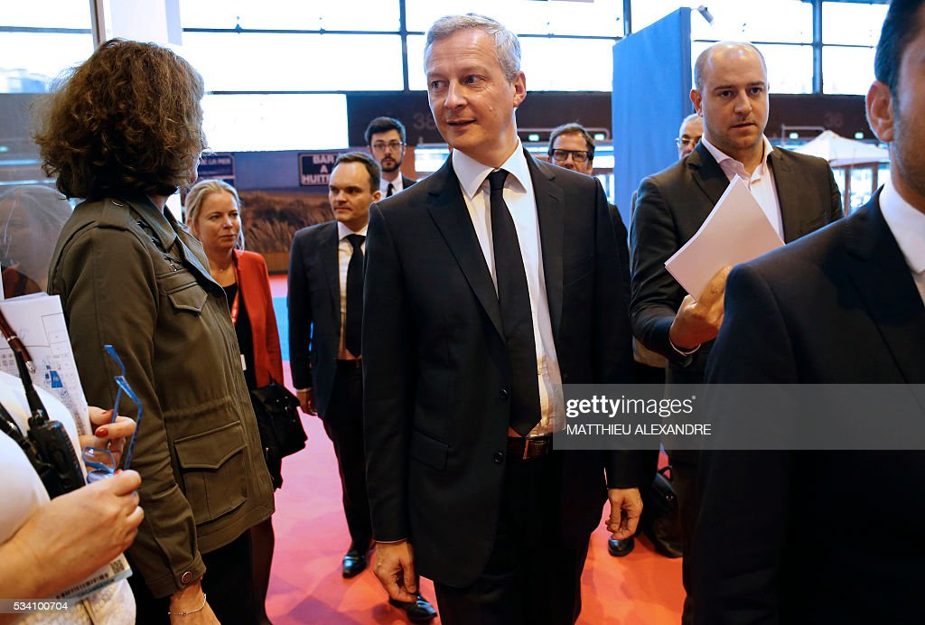 French right-wing Les Republicains (LR) party MP and candidate for the party's primary for the 2017 presidential election Bruno Le Maire arrives to deliver a speech during the Paris healthcare week on May 25, 2016 in Paris. / AFP / MATTHIEU