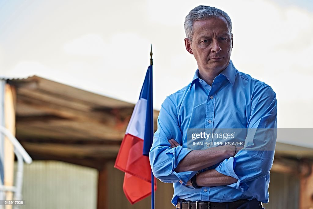 French right-wing Les Republicains (LR) party MP and candidate for the party's primary for the 2017 presidential elections, Bruno Le Maire, looks on as he pays a visit to farmers and producers of Charolais cattle, in Vendenesse-les-Charolles on June 30, 2016. / AFP / JEAN