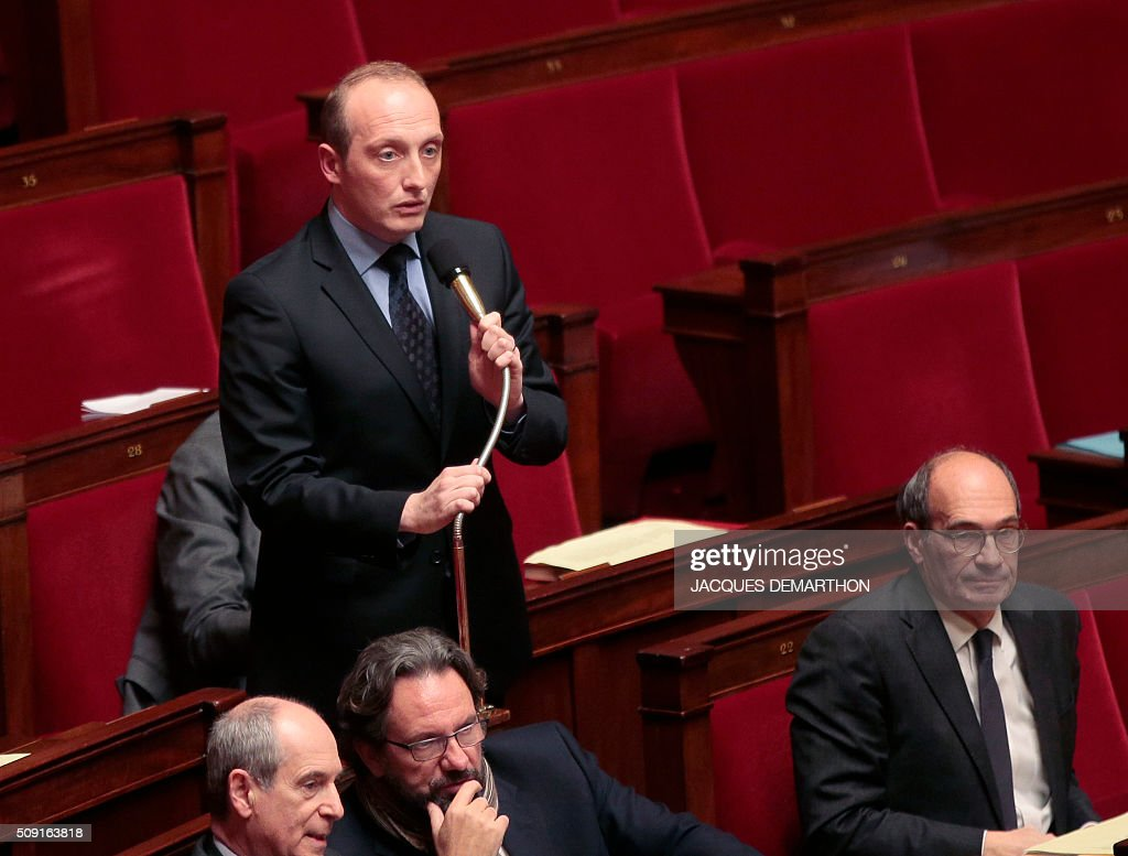 French right-wing Les Republicains (LR) party MP Laurent Marcangeli speaks at the French National Assembly in Paris on February 9, 2016, as French lawmakers examined proposed changes to the constitution. France's lower house of parliament is to vote on plans to enshrine a state of emergency into the constitution, including a controversial measure to strip French nationality from those convicted of terrorism and serious crimes. / AFP / JACQUES DEMARTHON