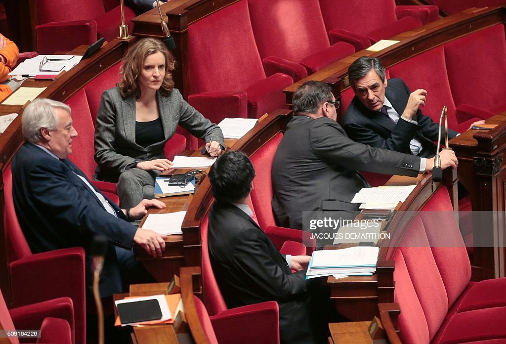 French right-wing Les Republicains (LR) party MPs (from L) Nathalie Kosciusko-Morizet, Claude Goasguen, Patrick Devedjian, Jean-Francois Lamour and Francois Fillon attend a debate at the French National Assembly in Paris on February 9, 2016, as French lawmakers examined proposed changes to the constitution. France's lower house of parliament is to vote on plans to enshrine a state of emergency into the constitution, including a controversial measure to strip French nationality from those convicted of terrorism and serious crimes. / AFP / JACQUES DEMARTHON