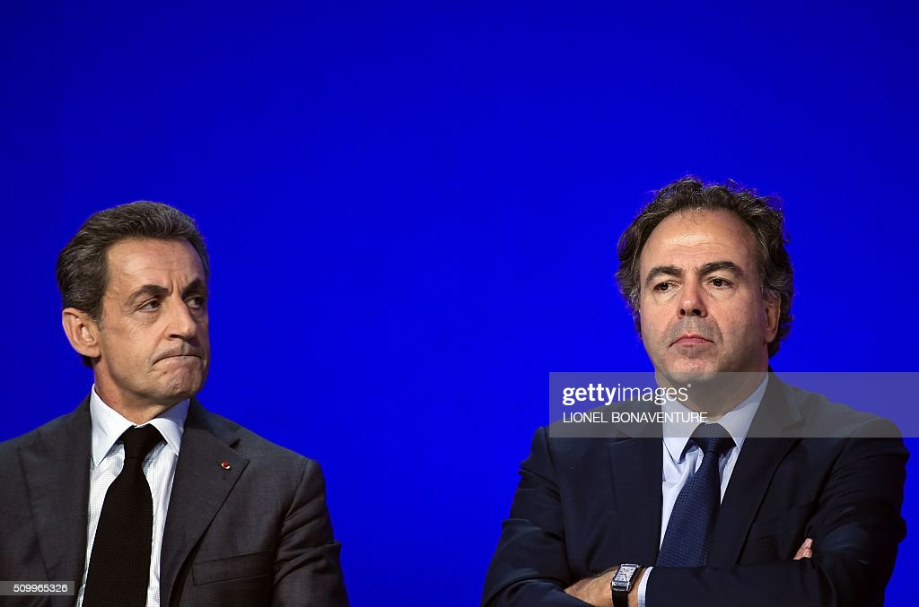French right-wing Les Republicains (LR) party President, Nicolas Sarkozy (L) and President of the LR National Consil Luc Chatel (R) look on during the LR National Council on February 13, 2016 in Paris. AFP PHOTO / LIONEL BONAVENTURE / AFP / LIONEL BONAVENTURE